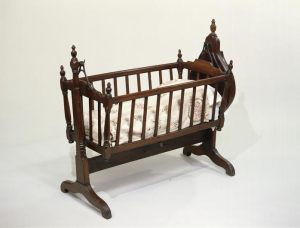 Wood and iron cradle, English, c.1810 (courtesy V&A Museum).
